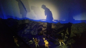 Diorama of men in the hellish trenches.